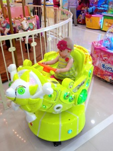 Baby rides at the arcade